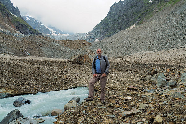 The river emerges from the dirty tongue of the glacier